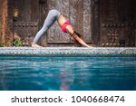 asia woman doing yoga fitness... | Shutterstock . vector #1040668474