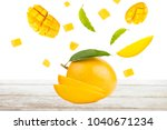 mango and falling of cut slice... | Shutterstock . vector #1040671234