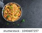 spaghetti pasta in tomato sauce ... | Shutterstock . vector #1040687257