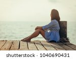 beautiful woman sitting alone... | Shutterstock . vector #1040690431