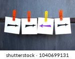 Small photo of Choice and originality concept, arrows drawn on notes on the dark background.