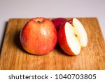 three red apples with shadow on ... | Shutterstock . vector #1040703805