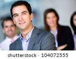 Successful young business man at the office - stock photo