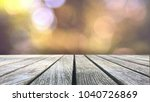 wood table over natural blurred ... | Shutterstock . vector #1040726869