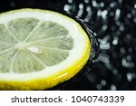 lemon ring with splashes of... | Shutterstock . vector #1040743339