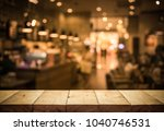 wood table top  bar  with blur... | Shutterstock . vector #1040746531