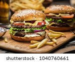 hamburgers and french fries on...   Shutterstock . vector #1040760661