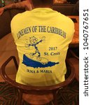 Small photo of St. Croix, U. S. Virgin Islands – November 29, 2017: Brought together to help in a national disaster, the camaraderie among electrical crews from across the nation shows in this commemorative shirt.