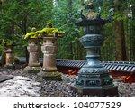 stone lanterns at toshogu...