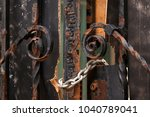 old forged gate. fragment of... | Shutterstock . vector #1040789041