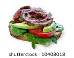 Open roast beef sandwich with avocado, salad, onion, and red onion.  Isolated on white. - stock photo