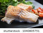 cod fillets with olives and...   Shutterstock . vector #1040805751