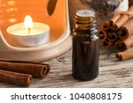 a bottle of cinnamon essential... | Shutterstock . vector #1040808175