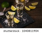 gold tequila shot with lime and ... | Shutterstock . vector #1040811904