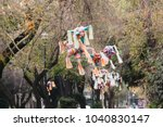 pinatas in the street  mexico... | Shutterstock . vector #1040830147