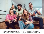 group of friends play video... | Shutterstock . vector #1040839849