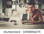 man working in design and... | Shutterstock . vector #1040846674