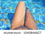 girl legs in swimming pool.... | Shutterstock . vector #1040846827