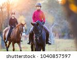 group of rider girls riding... | Shutterstock . vector #1040857597
