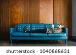 young man resting on the couch... | Shutterstock . vector #1040868631