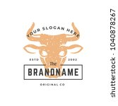 cow hand drawn logo isolated on ... | Shutterstock .eps vector #1040878267