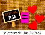 Small photo of Writing text showing Anything Else. Concept meaning Ask Asking Question to Have Answer written blackboard equatiMeaning Love Heart the textured background