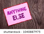 Small photo of Handwriting Announcement text showing Anything Else. Conceptual photo Ask Asking Question to Have Answer written Pink Sticky Note Paper the wooden background.