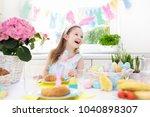 family easter breakfast. child... | Shutterstock . vector #1040898307
