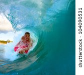boogie boarder riding a wave in ... | Shutterstock . vector #104090531