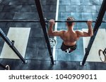 strong muscular man is working... | Shutterstock . vector #1040909011