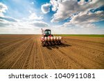 Farmer seeding  sowing crops at ...