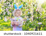 child on easter egg hunt in... | Shutterstock . vector #1040921611