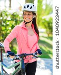 woman with a bike  outdoor | Shutterstock . vector #1040923447