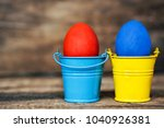 easter eggs in colored buckets  ...   Shutterstock . vector #1040926381