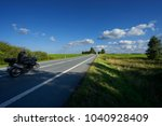 motion blurred black motorcycle ... | Shutterstock . vector #1040928409
