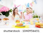 family easter breakfast. child... | Shutterstock . vector #1040956651