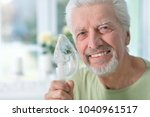portrait of an elder man making ... | Shutterstock . vector #1040961517
