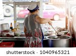 old lady cooking noodle in... | Shutterstock . vector #1040965321