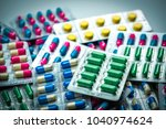 pile of colorful tablets and... | Shutterstock . vector #1040974624
