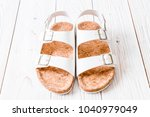 unisex leather sandals on wood...   Shutterstock . vector #1040979049