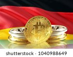 bitcoin coins on germany's flag ... | Shutterstock . vector #1040988649