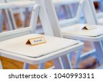 reserved sign on chairs at... | Shutterstock . vector #1040993311