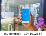 Small photo of CHIANG MAI, THAILAND - Mar 02,2018: Man holding Apple iPhone 6S Rose Gold with Twitter app.Twitter is an online news and social networking service where users post and interact with messages.