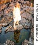 little girl standing on rock | Shutterstock . vector #1041045781