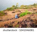 little girl standing on rock | Shutterstock . vector #1041046081