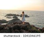 little girl standing on rock | Shutterstock . vector #1041046195