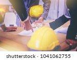 contractor and engineer discuss ... | Shutterstock . vector #1041062755