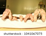 stylishly beautiful legs on bed ... | Shutterstock . vector #1041067075