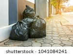 pile of black garbage on the... | Shutterstock . vector #1041084241