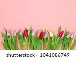 bouquet of tulips on a table... | Shutterstock . vector #1041086749